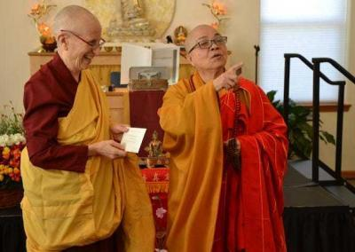 Ven. Master Wuyin offers a gift from abbess to abbess.