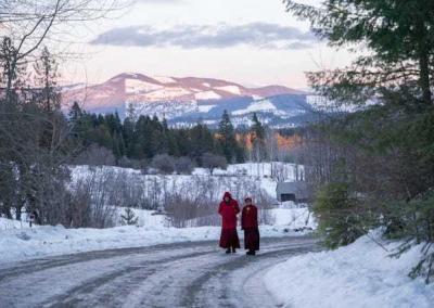 nuns walking on snowy road