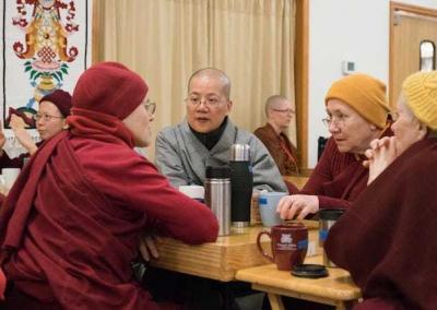 nuns chatting over tea