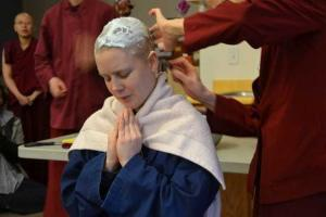 nun shaving novice's head