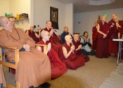Ven. Bhikshuni Master Wuyin looks on.