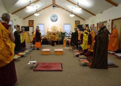 The sangha chants together as the preceptor - Ven. Chodron - makes an incense offering to the Buddha.