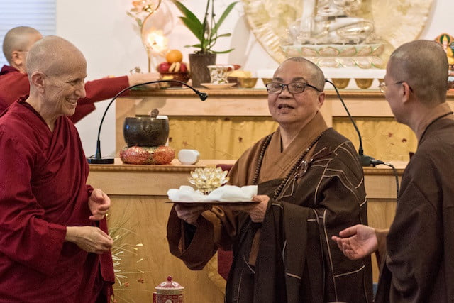 Chinese nuns offers a crystal lamp to Tibetan nun.