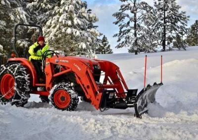 Ven. Losang and tractor move tons of snow - literally!
