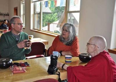 Ven. Jigme connects with Dan and Cheri who offer service with the prison outreach project.