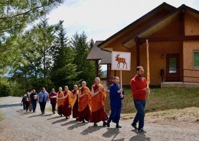 The kathina procession heads to the Meditation Hall.