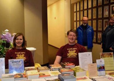 Janet and Gabe welcome folks and answer questions before Ven. Chodron's talk at North Idaho College.