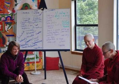 LaShelle guides Ven. Chonyi through one of the NVC exercises.