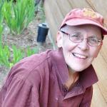 smiling nun in garden