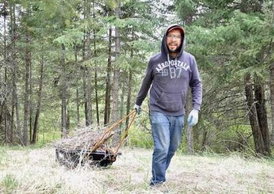 Renato makes use of the of the Abbey's sleds to transport material for the burn pile.