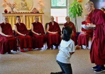 Ven. Tarpa gives Joline a gift in gratitude for her years of supporting the Abbey sangha.