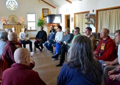 """The Offering Service Saturday group gathers to get their """"orders"""" for the day's tasks."""