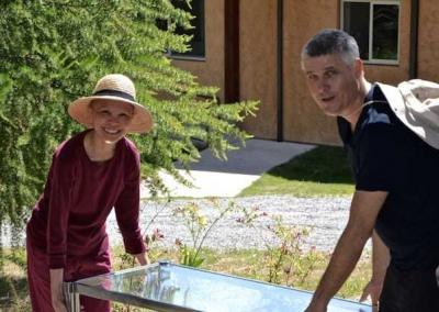 Ven. Pende and Chris from Australia clean the Meditation Hall.