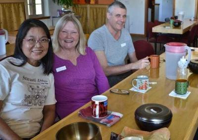 Singaporean visitor Seow Hong, a local guest, and Chris prepare to attend the meditation.
