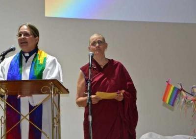 Rev. Gen Heywood and Ven. Chonyi share the podium at the Spokane Pride Interfaith Service.