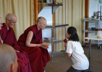 Joline makes heartfelt offerings to the sangha.