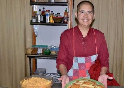Ven. Nyima provides the community with Colombian food.