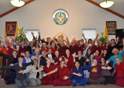 A happy group visualizes Chenrezig's thousands arms reaching out to help all sentient beings.