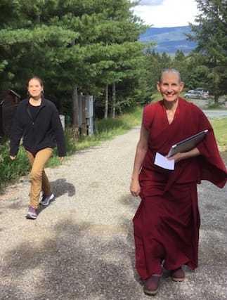 Ven. Tsepal and Andrea heading towards the Meditation Hall.