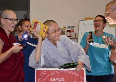 """Ven. Wangmo, Christina, Ven. Zi-Chi, and Stacy joyfully play out their experience """"organizing the freezer"""" in one of the skits."""