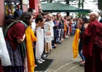 A happy crowd greets Venerable Chodron before her talk at Tushita Meditation Centre - Dharamsala.