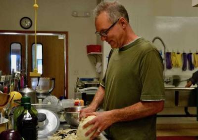 Dan prepares jicama for a special lunch salad.