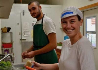 Diane and Matt connect while joyfully washing veggies.