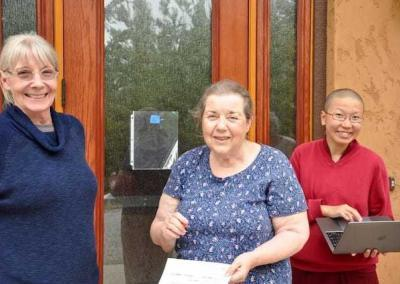 Bev, Mary-Louise, and Ven. Damcho prepare to greet the retreat guests.