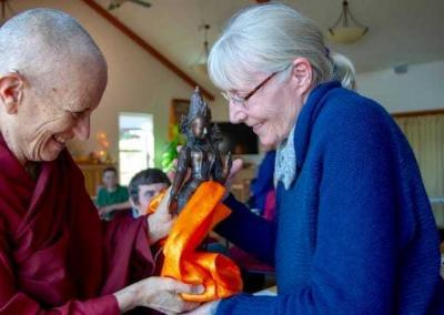 Ven. Chodron offers Bev a bodhisattva statue to thank her for her tremendous contribution.