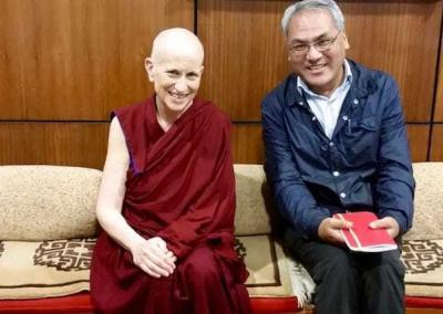 Venerable goes over meeting notes with Tsepak, His Holiness' English interpreter.