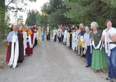 Guests and residents joyfully wait to welcome Ling Rinpoche to Sravasti Abbey.