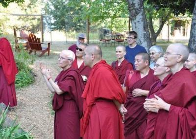 The Abbey community shows Rinpoche the property and talks about our history.