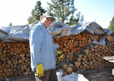 Dave offers his strength in hauling wood as well as his joy, enthusiasm, and love for community.