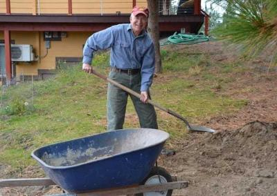 With joyous effort Ken digs into the landscaping around Prajna Cottage.