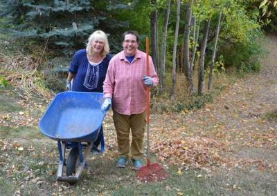 Bernie and friend Candance rake leaves to cover the winter's compost.