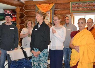 Guests and monastics wait for Ven. Chodron to arrive in the Meditation Hall before teachings.