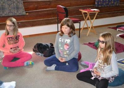 Campfire kids join the Abbey for meditation and a joyful exploration of the Buddha Dharma.