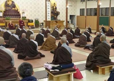 Luminary monastics and lay students listen to a talk by Ven. Chodron.