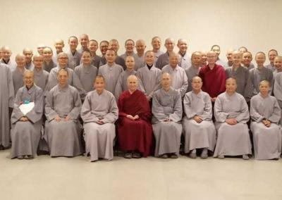Dharma Drum nuns gather for a group picture with Ven. Chodron and Ven. Damcho.