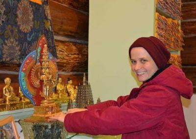 Ven. Jampa helps to place Chenrezig on his seat of light on the altar.