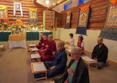 Retreatants recite the mantra of the Buddha of Compassion.