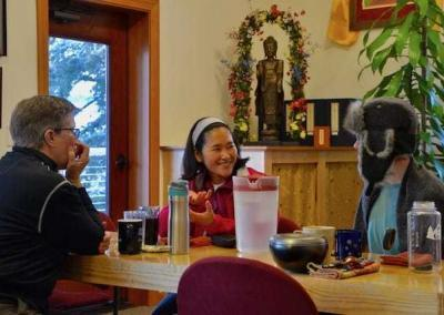 Kathy, Kuni, and Em use their study time to discuss the Dharma.