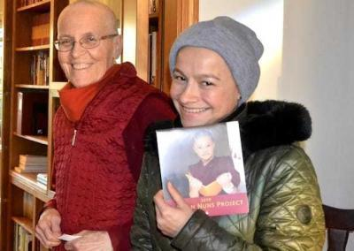 Ven. Semkye and Aidee appreciate the 2019 Tibetan Nuns Project calendar.