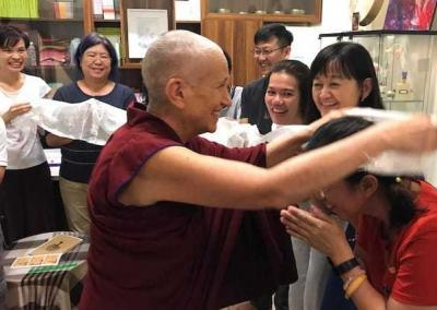 Ven. Chodron's students greet her joyfully before the first talk at the Awareness Hub.