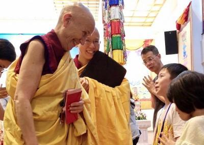 Two of the youngest students happily meet Vens. Chodron and Damcho.