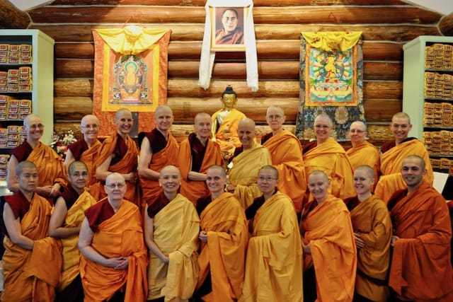 monastics pose for photo