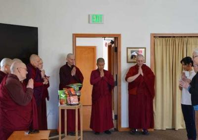 Our friends offer food to the sangha.