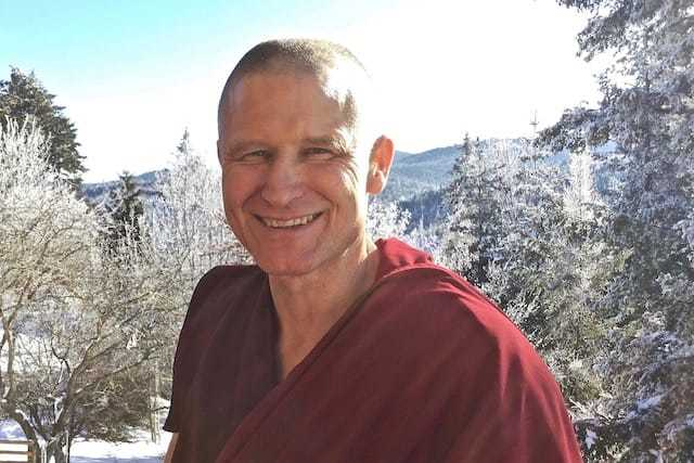 Smiling monk with snowy background