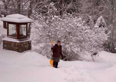 Sherran uses the morning break to shovel in the garden.