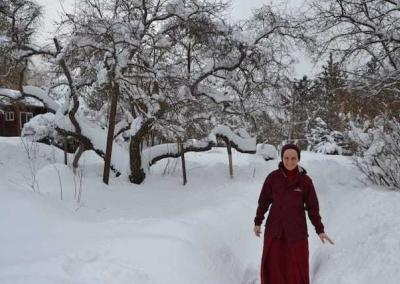 Ven. Jampa rejoices in the amount of snow that collects in the garden.